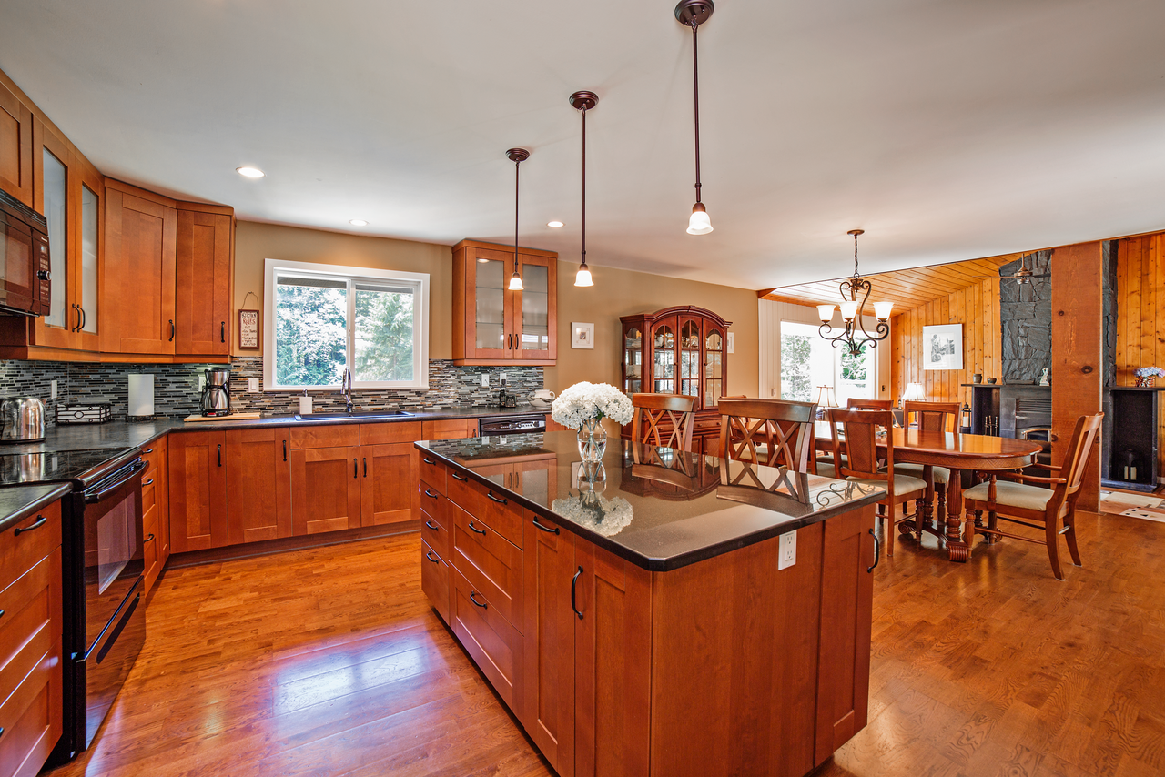 kitchen with island in home for sale in Mission BC
